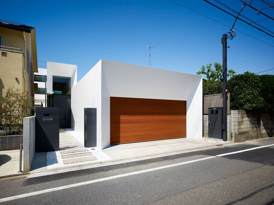 Simple House Facade Design with Wooden Garage Door